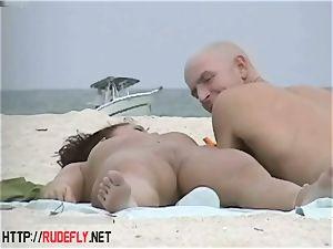 highly kinky milf caressing boobies in nude beach
