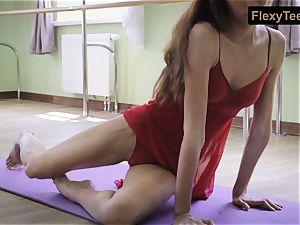 crazy gymnast Inessa in a crimson dress