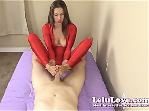 dressed female gives you hand job and footjob