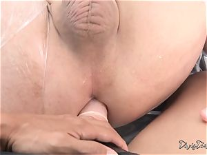 Dana mistreats her fellow with a giant faux-cock