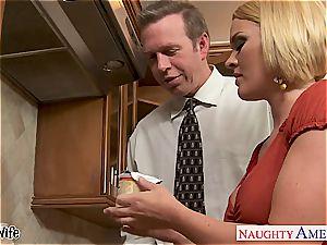 buxomy wife Krissy Lynn gobbling jizm in the kitchen