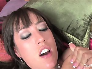 huge-titted Capri Cavanni humps on the bed